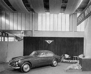The Jensen sign on prominent display at the 1964 Motor Show.