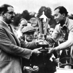 Charles Follett giving a prize to Prince Bira in 1937.