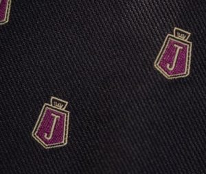 Detail of 'J' logo to the second style Jensen tie.