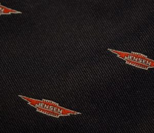 Detail of woven winged Jensen logo.