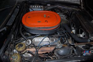 Engine-bay of GEA 77K when the present owner acquired the car. Six -pack carburettor system still in place.